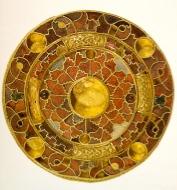 Museo archeologico di Parma, Fiibula a disco, VII sec.